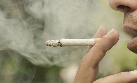 closeup of person smoking