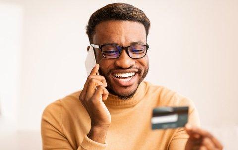 happy black man with credit card