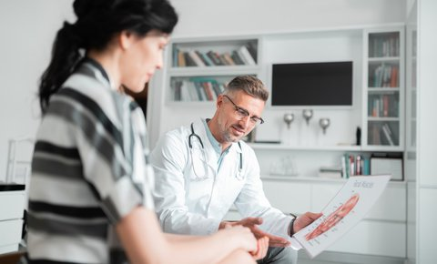 patient consults with plastic surgeon