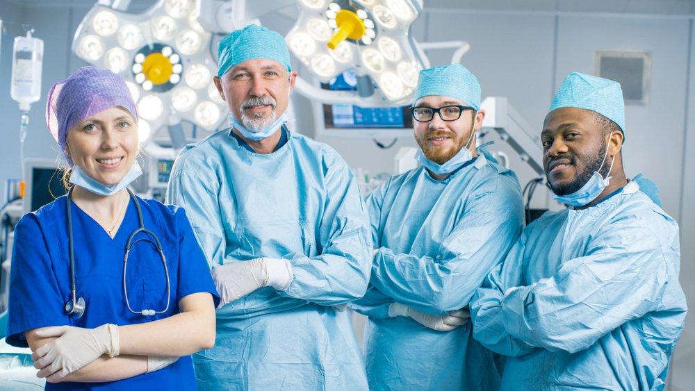 surgeons smile in operating theatre