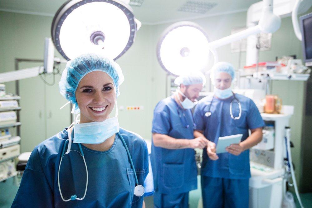 Surgeons smiling in theatre