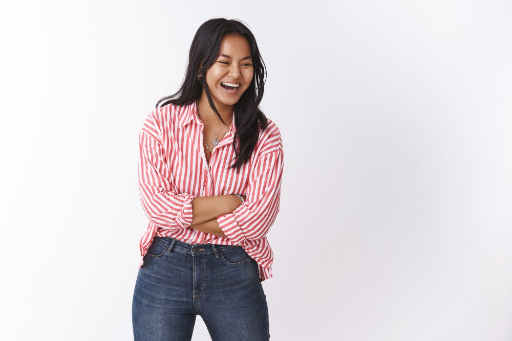 woman in striped shirt laughing